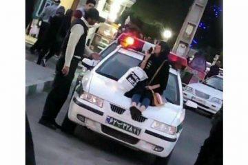 دختر بدحجابی که روی ماشین پلیس در آذربایجان غربی نشست بازداشت شد + عکس